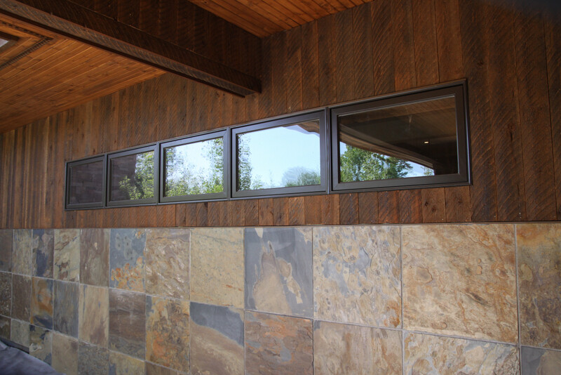 Exterior integration of ranchwood with stone and window materials image